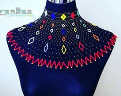 This cape Zulu beaded jewelry set is ideal for wearing over a broad shoulder dress or shirt. It is absolutely gorgeous and will complement any outfit. It is worn by Zulu women at weddings and special occasions. African Necklace, African Beads, African Jewelry, African Accessories, Neck Accessories, Bead Jewellery, Beaded Jewelry, Beaded Necklace, Choker Necklaces