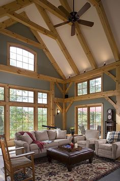 Great room photo in an Eastern White Pine Woodhouse timber frame home