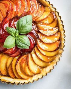 I've got 99 problems, but a peach ain't one. Tequila Glazed Peach Tart. Simple as can be. Have a shot of tequila, make a sweet butter crust, fill it with peaches (leaving them thinly sliced and fresh this time), and glaze it with whatever tequila you may have left after the chef's share.
