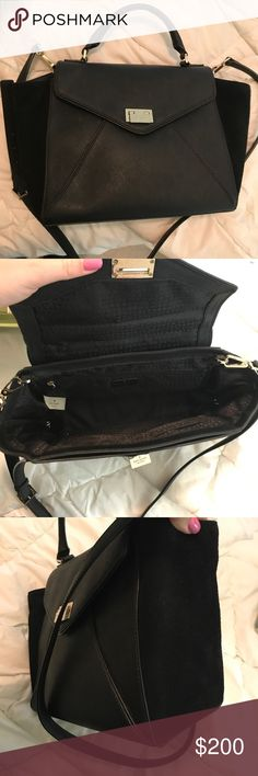 Kate spade black leather and suede messenger bag Rare Kate Spade black leather bag with suede detail on sides. Has top handle as well as detachable shoulder/crossbody strap. Still in great shape and has been cared for. Receive a ton of compliments every time I use it, and one of my friends on here might even see this and buy it. 12 x 10 x 5 kate spade Bags Totes