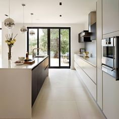 Discover kitchen design ideas on HOUSE - design, food and travel by House & Garden. Spacious, contemporary, clean and light. This is a kitchen that dreams are made of...