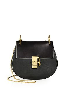Great black purse with gold accents from Chloe.  Good shoulder bag...reminds me of a satchel!