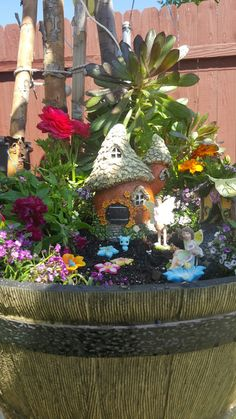 My Fairy Garden . most items I bought from Big Lots . they have a fairy gnome section there .