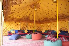 sunny bedouin tent design notes: brass hanging lanterns, low day bed type seating, lots and lots of cushions