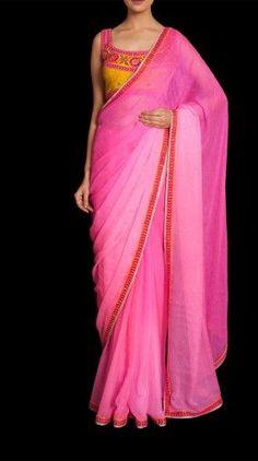 Pink chiffon saree with yellow sleev less blouse by Ritu Kumar