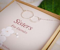 One of my faves, classic sisters necklace, Sterling Silver Infinity interlocking circles on card. One for each sisters, neither will want to take off. Delicate and understated, goes with everything and perfect for layering.