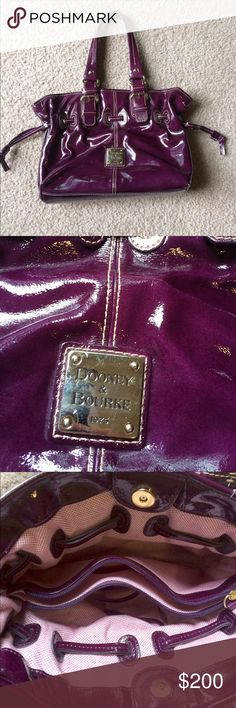 Dooney & Bourke patent leather bag Beautiful purple patent leather handbag. Two straps. 3 slot inside. Key holder. Cell phone pocket. 1 zip middle. 1 large zip pocket. Excellent condition other than tiny spot on bottom corner of purse. Dooney & Bourke Bags Shoulder Bags