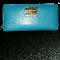Michael Kors Zippy wallet Michael Kors Zippy Wallet. Gorgeous teal color, gold hardware with hairline scratches,  and barely noticeable wear on the corners. Used for a year or so but still in amazing condition! Zipper doesn't stick,  and only slight discoloration in the change pocket. 8 card slots. Michael Kors Bags Wallets