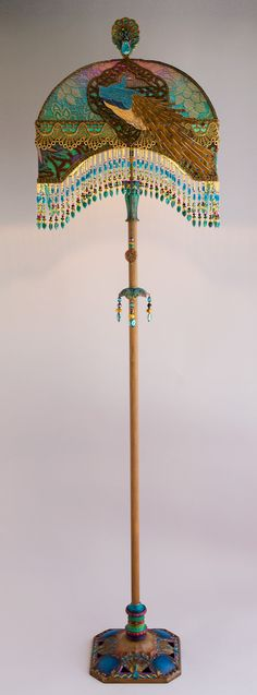 Detail of Peacock Lamp - Christine Kilger creates one-of-a-kind lighting.  These are absolutely stunning pieces!