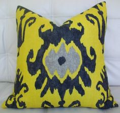Ikat pillow in yellow , black and grey