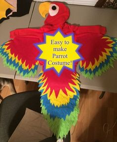 Easy to make Parrot Costume. No link, just the picture. Red hoodie, felt wings a. Easy to make Parrot Costume. No link, just the picture. Red hoodie, felt wings a. Pirate Halloween Costumes, Halloween Kostüm, Holidays Halloween, Baby Parrot Costume, Bird Costume, Animal Costumes, Baby Costumes, Family Costumes For 3, Drawing Simple