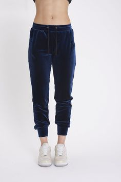 "Super luxurious blue velvet jogger pants with pockets. Material: 95% Polyester, 5% Spandex. Measurements: Inseam 9.5"" Length 31"". Imported"