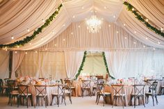 I love the draping, chandelier and old-fashioned lights and green garlands in this wedding reception tent! A glam desert wedding by onelove photography - Wedding Party