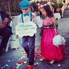 Cutest ring bearer and flower girl! Teal and coral wedding.