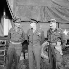 General Eisenhower, Supreme Commander Allied Forces (centre), with Lt Gen Dempsey (C-in-C British 2nd Army) and Lt General Ritchie (12 Corps Commander - right) at 12 Corps HQ, November 1944.