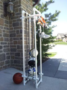 PVC ball holder; materials and measurements used: PVC cutter or saw, drill with 3/8 bit, 3/4 or 1 inch pipe, 4-T's, 8- X's, 6- 90 degree elbows, 4- pipe cut at 48 inches, 8- pipe cut at 4 inches, 5- pipe cut at 8 inches, 8 bungee cords at 36 inches. Built this for under $25. Follow picture to assemble, use drill to drill out holes to hook bungee cords to. Wrap two opposite side of bungees (4 total) around base and hook to opposite side to create the bottom. Put extra pipe on top for cleat…