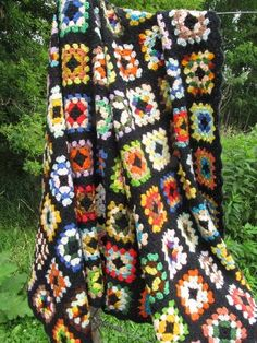 vintage granny square crochet afghan blanket, black with bright yarns