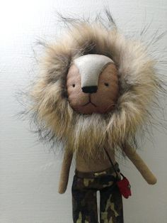 Great lion doll for the kiddos - not sure about the little purse?? but to each they're own, I guess :)