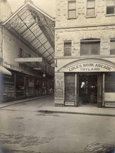 Beside the Yarra: Lost Treasures: Coles Book Arcade The Collins Street entrance to the arcade with a sign for 'Toyland' to the right and the glass roofed arcade to the left. Melbourne Girl, Melbourne Suburbs, Melbourne Victoria, Victoria Australia, Melbourne Australia, Australia Travel, Art And Illustration, Australian Continent, Largest Countries