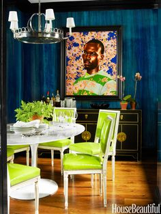 The shock of chartreuse against deep blue walls, painted a faux-marble finish by Chris Pearson, makes the formal dining room more fun. Louis XVI–style dining chairs by John Derian covered in Élitis's vinyl surround the Saarinen table. Griffin chandelier, Visual Comfort. Painting by Kehinde Wiley.