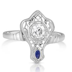 The Ari Ring from Brilliant Earth circa 1920's Intricate latticework adorns this lovely Edwardian ring in white gold. An old European cut diamond flourishes in the center and a marquise-shaped natural sapphire accent adds the perfect touch (approx. 0.25 total carat weight).