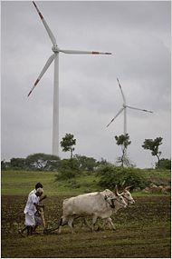 Dilip Pantosh Patil uses an ox-drawn wooden plow to till the same land as his father, grandfather and great-grandfather. But now he has a new neighbor: a shiny white wind turbine taller than a 20-story building, generating electricity at the edge of his bean field.