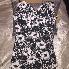 Black and white floral sun dress! Little sun dress, great for summer, that slips on and off. Only wore it twice! It has flower print in black and white and on the bottom the dress slants as you can see in the second picture. Dresses Mini