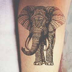 Amazing black ink Elephant tattoo on leg