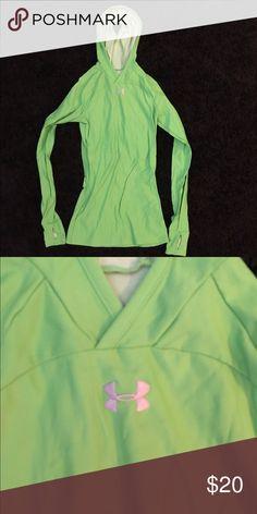 Under Armor Running Shirt Heat Gear running shirt, has ponytail holder in hood, worn a few times. Under Armour Tops Sweatshirts & Hoodies