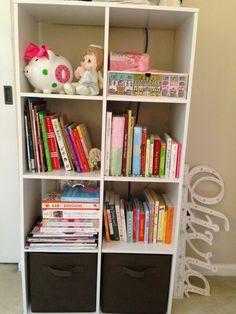 organized baby nursery bookshelf