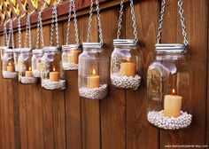 Mason jar candles, such a cute idea if you have a fence.