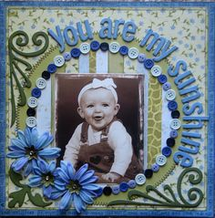 Layout: You are my sunshine..  Like the use of buttons on frame and title circling picture.