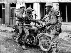 Here some British Despatch riders show off their BSA M20 to Allied soldiers.