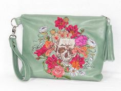 Skull and roses Springtime bouquet embroidery on mint green genuine leather zipper clutch accommodates essentials with carefree convenience. Easily carried by r