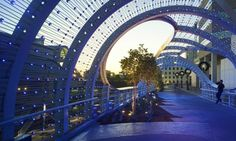 California-based SPF Architects just unveiled a beautifully breezy pedestrian bridge connecting two major Long Beach venues. The Rainbow Bridge - whose wavy form was inspired by the local beaches - is an elegant 600-foot walking path interspersed with mini garden spaces. The bridge's canopy features 3,500 color-changing LED nodes, which can be programmed and synced with music to create a beautiful light show as people wander cross.
