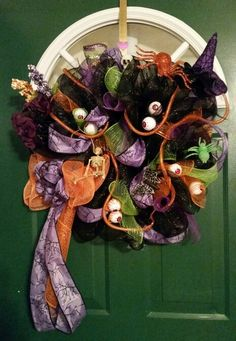 I made this Halloween Deco Mesh Wreath for Denise
