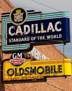 Cadillac service sign.  With Oldsmobile service sign.  Oldsmobiles had slightly less distinction with almost the exact same quality as Cadillacs.  They were considered one step below Cadillacs.