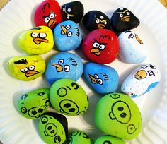 Angry Birds DIY using rocks. ~ NOTE: I personally wouldn't recommend arming children with large painted Angry Birds rocks  & sling shot, But I ♥ them anyway.  Ironically, this was posted for a craft with children & I would think it cute to have these in a funky bowl in my apartment!