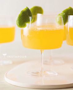#ChampagneWeek2015   ● NAME: Citrus and Ginger Champagne #Cocktail ● CREDITS: Spoon Fork Bacon Blog ● DETAILS: Fresh Lime + Tangerine Juice, Ginger Syrup, Chilled #Champagne, Garnished with Citrus Peel  Instapour.com
