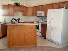 look at what white cabinets will do for a kitchen.  before and after.