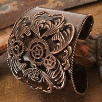 3-D gears, butterflies, and hearts adorn this cuff. If antique style is your thing, then check this out! #steampunk #cuff
