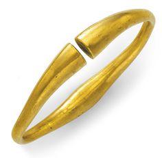 An Achaemenid gold bracelet, circa 5th century BC. Starting bid $20,000.