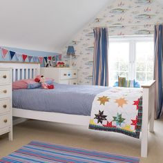I love the brightness of this room. The star quilt on the end of the bed is adorable.