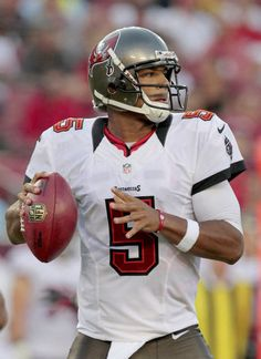 Tampa Bay Buccaneers quarterback Josh Freeman drops back to pass in an NFL preseason game between the New England Patriots and the Buccaneers Friday, Aug. 24, in Tampa, Fla.