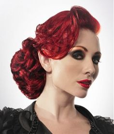 A long red straight wavy coloured ponytail hairstyle by Patrick Cameron