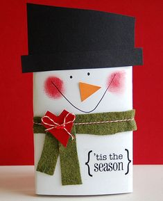 This is such an easy project. Start with a package of microwave popcorn. Wrap a piece of white cardstock around it. Draw a face with a pen. Add a carrot nose, scarf and hat. Finish it off with a sentiment in the corner.