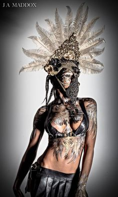 Model: Syri Celestine Body Paint: Michael Rosner of EYE LEVEL STUDIO Headpiece: Miss G Designs Hair & MUA: Yuma Bastet Photography & Leather(Top&Skirt): Joshua Maddox of Maddox Leather Design #headdress #headpiece #crown #mask #bodypaint #missgdesigns