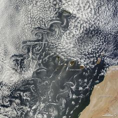 Canary Islands Kick Up Von Kármán Vortices: Known as von Kármán vortices, the remarkable curling patterns can form nearly anywhere that fluid flow is disturbed by an object.