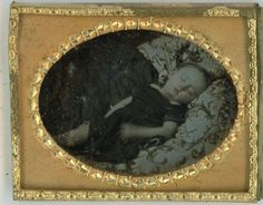 Post-Mortem-Daguerreotype-or-Maybe-Sleeping-Child-Because-Hand-has-Moved