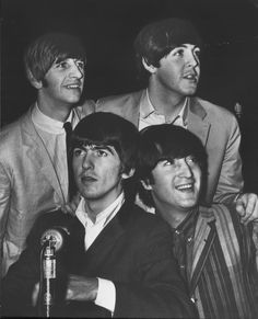 Photo from the Star-News book Hoosier Century The Beatles--(clockwise from lower left) George Harriston Ringo Starr Paul McCartney and John Lennon--arrived in two other U.S. cities before coming to the Indiana State Fairgrounds on Sept. 3 1964 for two concerts the next day. This photo was taken by Frank Salzarulo of The Indianapolis News at the Philadelphia stop. (Photo: STAR/NEWS)